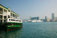 Framed Star ferry on a pier with buildings in the background, Central District, Hong Kong Island, Hong Kong