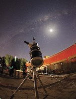 Framed Astrophotography setup with the moon and Milky Way in the background
