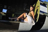 Framed Sexy 1940's style pin-up girl sitting inside of a C-47 Skytrain aircraft
