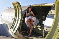 Framed Sexy 1940's style pin-up girl standing inside of a C-47 Skytrain aircraft