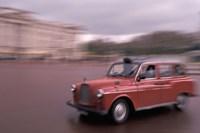 Framed Cab racing past Buckingham Palace, London, England