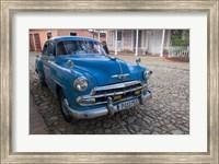 Framed Cuba, Trinidad Blue Taxi Parked On Cobblestones