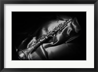 Framed Black And White Still-Life Image Of A Brass Clarinet