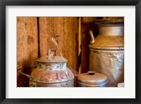 Framed Old Milk Containers From A Dairy Farm