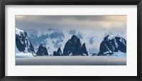 Framed Antarctic Peninsula, Antarctica, Spert Island Craggy Rocks And Mountains