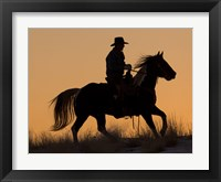 Framed Cowboy Riding His Horse Winters Snow Silhouetted At Sunset