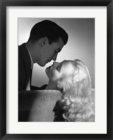 Framed Movie Star Studio Style Romantic Couple Embracing On Sofa About To Kiss