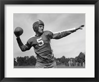 Framed Quarterback About To Toss Football Pass