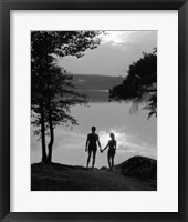 Framed Man And Woman In Bathing Suits Holding Hands Watching Sunset Lakeside
