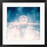 Framed Moonrise Over the Clouds