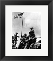 Framed American Soldiers raise the first US flag at  Iwo Jima 1945
