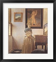 Framed Young Woman Standing At a Virginal