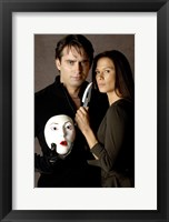 Framed Nip/Tuck - couple with a mask