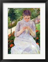 Young Woman Sewing in the garden Framed Print