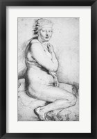 Framed Young nude woman seated