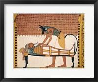 Framed Anubis attends Sennedjem's Mummy