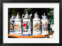 Framed Group of beer steins on a table, Munich, Germany
