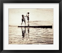 Framed Two boys standing on a wooden platform in a lake