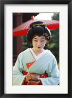 Framed Young woman dressed as a Geisha, Japan