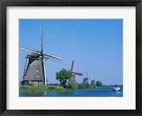 Framed Windmills and Canal Tour Boat, Kinderdijk, Netherlands