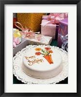 Framed High angle view of a birthday cake with gifts