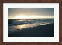 Framed Waves breaking on the beach at sunrise