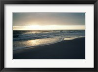 Framed Waves breaking on the beach at sunrise
