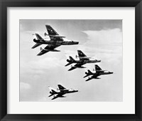 Framed Low angle view of four fighter planes flying in formation, F-100 Super Sabre