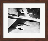 Framed Low angle view of a bomber plane carrying missiles during fight, AGM-28 Hound Dog, B-52 Stratofortress