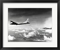 Framed Side profile of a military tanker airplane refueling in flight, B-29 Superfortress, F-84 Thunderjet