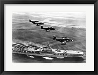 Framed High angle view of four fighter planes flying over an aircraft carrier, US Navy Banshees, USS Coral Sea (CV-43)