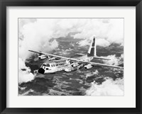 Framed High angle view of a military airplane in flight, C-130 Hercules