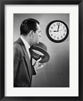 Framed Businessman looking at clock