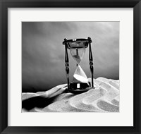 Framed Close up of hourglass on sand
