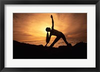 Framed Silhouette of a young woman practicing yoga, Haleakala, Maui, Hawaii, USA