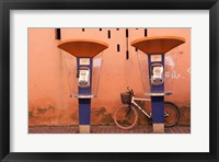 Framed Public telephone booths in front of a wall, Morocco