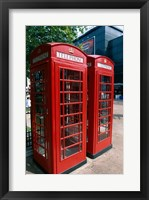 Framed Two telephone booths, London, England