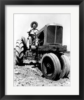 Framed Farmer Sitting on a Tractor in a Field
