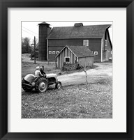 Framed Man with a Boy Riding a Tractor in a Field