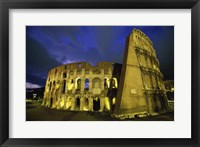 Colosseum lit up at night, Rome, Italy Framed Print