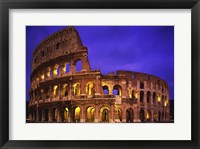 Framed Low angle view of a coliseum lit up at night, Colosseum, Rome, Italy
