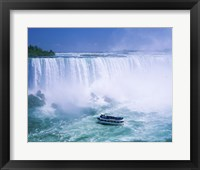 Framed High angle view of a tourboat in front of a waterfall, Niagara Falls, Ontario, Canada