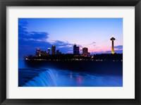 Framed Waterfall with buildings lit up at dusk, American Falls, Niagara Falls, City of Niagara Falls, New York State, USA