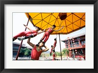 Framed Group of children performing acrobatics, Shanghai, China