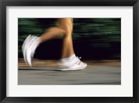 Framed Low Section View Of A Person Running In White Sneakers