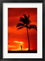 Framed Silhouette of a man running by a palm tree at sunset, Maui, Hawaii, USA