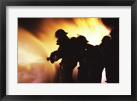 Firefighters Extinguishing A Fire With Water Framed Print