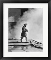 Framed Firefighter walking in front of smoke