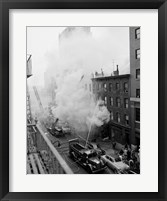 Framed New York City, Fire on East 47th Street, with fire engines shooting water on burning building