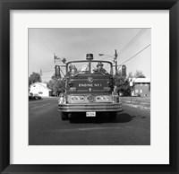 Fire engine on road Framed Print